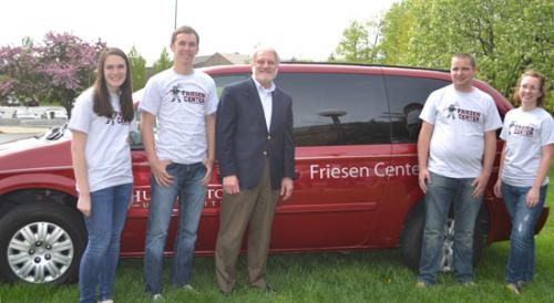 A van used by Huntington University's Friesen Center for Volunteer Service displays the center's new name, honoring HU administrator Dr. Norris Friesen (third from left).
