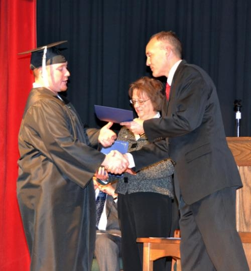 Randall Travis Hunt (left) accepts his diploma from Tracey Shafer, superintendent of the Huntington County Community Schools, during a GED graduation ceremony Friday evening, Jan. 31, at the Horace Mann Education Center, in Huntington.