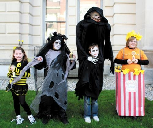 Costume contest winners (from left) Avery Drabenstot, Bailey Clark, Gavin Page and Rachael Fulton pose during the 2011 Great Pumpkin Festival in downtown Huntington.