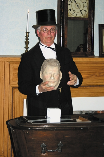 Retired funeral director Bruce Van Gilder displays a death mask during a past Ghost Walk at the Forks of the Wabash Historic Park. Van Gilder will return for this year's event, scheduled for Saturday, Oct. 20.