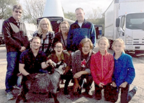 "The Leidig family of Warren recently traveled to Chicago so a pygmy goat they own, named ""Custer,"" could have a role in the Showtime network show, ""Shameless,"" starring William H. Macy and Emmy Rossum. In the front row (from left) are Josh Leidig, Emmy Rossum, William H. Macy, Alexis Leidig and Breanna Leidig, and in the back row (from left) are Bill Casey, the show's animal wrangler; Leidig family friend Jolie Wariner, Kelly Leidig and Tim Leidig. Photo provided."