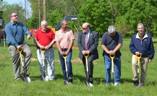 Huntington city officials turn shovels of dirt at Elmwood Park during a groundbreaking ceremony on Wednesday, May 15, for the Frederick Street interceptor sewer and recreational trail project.
