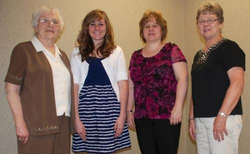 Parkview Huntington Hospital Guild Scholarship Chair Carol Strickler (left) presents a guild scholarship to Laura Cherry (second from left).