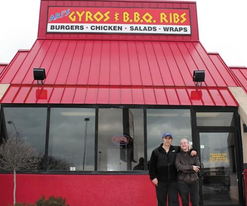 Ari Lambridis (left) and Maria Ftergiotis stand outside their new restaurant, Ari's Gyros and B.B.Q. Ribs, in Huntington. Lambridis and Ftergiotis own four similar restaurants in Mishawaka, South Bend, Elkhart and Goshen.