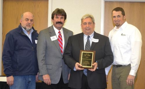 Tom Lund (third from left), operations manager at Isolatek International, Huntington, accepts an award of appreciation from Huntington County Economic Development for his company's investment in Huntington during 2012.