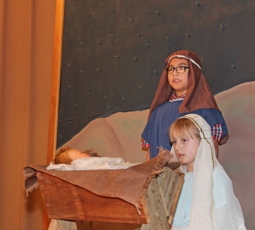 Huntington Catholic School students Jesus Mendoza (left) and Cheyenne Catellier portray a young Joseph and Mary in a Nativity tableau during the school's annual Christmas program on Wednesday, Dec. 6.