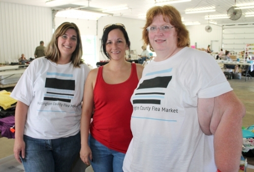 Diana VanBuskirk (right), along with her assistants Holly Houser (left) and Kristy Moore, run the new Huntington County Flea Market, which had its opening day on Saturday, Aug. 4, in the First Federal Savings Bank Community Building at the Huntington County Fairgrounds. The market is planned to be open the first Saturday of each month.