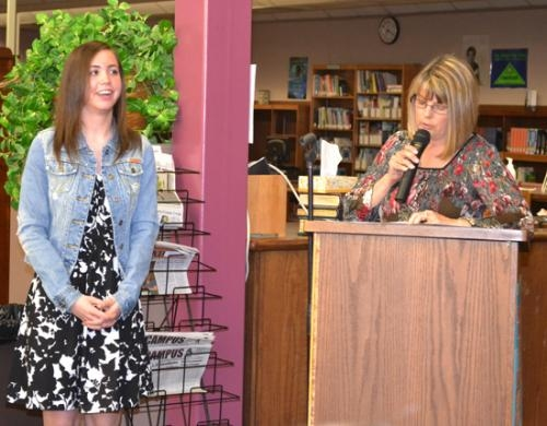 Kayla Patrick (left) listens as Huntington North High School guidance counselor Elaine Willour announces Patrick's name as valedictorian of the HNHS class of 2013. The announcement was made Tuesday, April 23, during a breakfast in the school library.