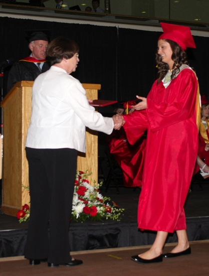 Candie Armstrong (right) accepts her diploma from Huntington County Community School Board of Trustees member Sarah Kyle at the Class of 2013's graduation ceremony on Friday, June 7.