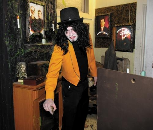 Garrett Adkins is in character at a preview night of the Haunted Hotel – 13th Floor, in downtown Huntington on Thursday, Sept. 27. The hotel officially opened for the season on Friday, Sept. 28.