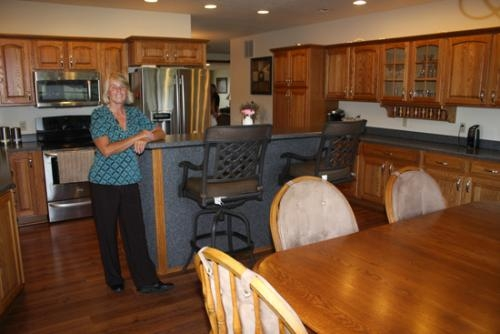 Donna Hedrick stands inside the kitchen of her home on Division Road. The Hedrick home will be one of five stops on the Tri Kappa Housewalk on Oct. 14.