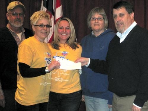 Cottage Event Center donated a check to Northeast Indiana Honor Flight recently.