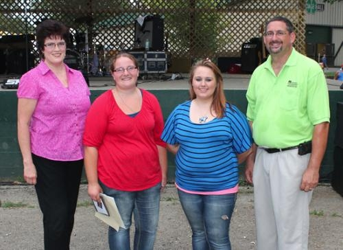 Bonnie Hardy and Alyssa Aughinbaugh (second and third from left, respectively) were named the top two 4-H 10-year members during a ceremony recognizing 10-year 4-H members and graduating 4-H members at the United REMC Outdoor Stage at Hier's Park.