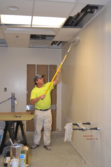 Michael Emenhiser, of Strahm Group, paints a wall on Thursday, March 7, in a room that will become part of Parkview Huntington Hospital's new pediatric rehabilitation therapy unit. The unit is expected to open in mid-April.