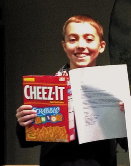 Isaac Hostetler displays his awards after winning the Northwest Elementary School spelling bee.