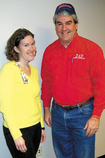 Megan Bobay, Junior Achievement board president, thanks Andy Zay, of Zay Leasing and Rentals Inc., for his service to JA.