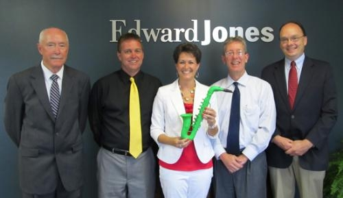 Jim Warner, Trent McBride, Nicole Johnson, Jim Ditzler and Jim Scheiber (from left), all of Edward Jones, are the official sponsors ofthe musicfor JeFFFest. Chuck Harris and Katie Harris, also Edward Jones associates, are not pictured.