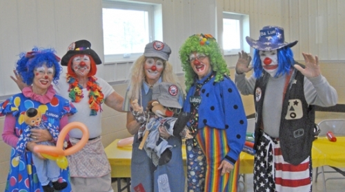 Members of the Joy Pleasers Clown Ministry cheese for the camera. Pictured are (from left) Lollipop (Ann Ericsson), Piper (Susan Miller), TidBit (Midge Decker), Lullaby (Johanna Lange) and BaLue (Mark Bickel). The group is holding classes for potential new members, beginning Feb. 17.