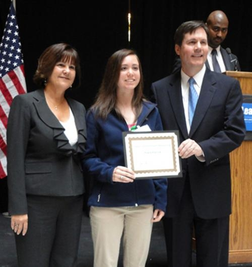 Kayla Patrick (center) receives the 2013 Comcast Leaders and Achievers Scholarship from Indiana First Lady Karen Pence (left) and Tim Collins, senior vice president of the Comcast Heartland Region.