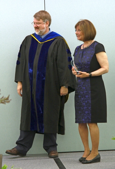 Debra Kriegbaum (right), of Huntington, was named 2013 salutatorian of the bachelor's degree program in Huntington University's Professional Programs. With her is Dr. Stephen Holtrop, dean of graduate and professional programs at HU.