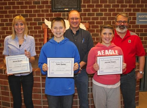Crestview Middle School students Tyler Gates and Jaycee Thorn (front row, from left) and Stone Myers (not pictured) were named Artists of the Month for November by the LaFontaine Arts Council.