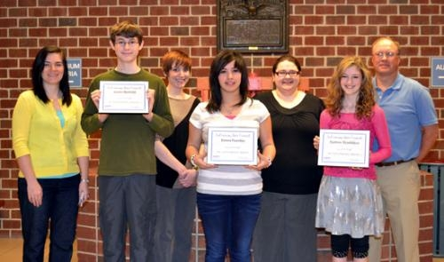 Crestview Middle School students (front row, from left) Justin Beihold, Elania Fuentes and Sydnee Gradeless have been named artists of the month for April by the LaFontaine Arts Council.