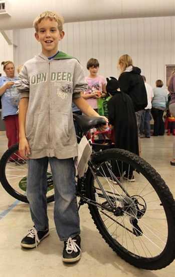Michael Kline won a new bicycle after finding the specially marked egg for the 8 years and older age group in the Huntington Parks and Recreation Department's Great Pumpkin Hunt on Oct. 25.