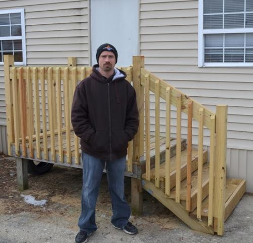Larry Young, the new office and maintenance manager of Wall's Mobile Estates, stands in front of one of the newly renovated structures available for rent in the park. Wall's Mobile Estates has been under new ownership as of November 2012.