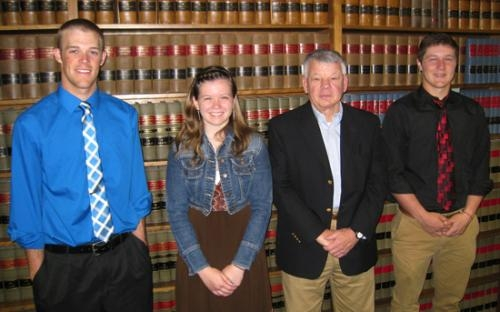 The law firm of Bowers, Brewer, Garrett & Wiley, LLP, represented by Robert Garrett (third from left) has presented 2013 scholarships to (from left) Caleb Richison, Rebecca Smith and Drew Schnitz.
