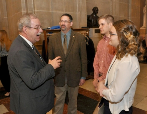 Rep. Dan Leonard (left) chats with members of the Huntington County Farm Bureau (from left) Paul Jacobs, Bailey Rothrock and Karley Hockemeyer during the recent Indiana legislative session.