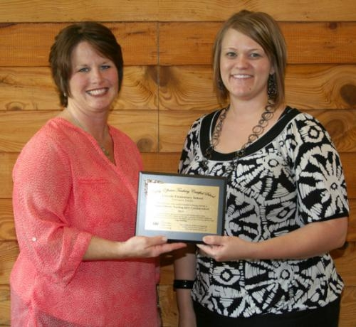 Lincoln Elementary School teachers (from left) Zella Walborn, fifth grade, and Ashley Ransom, first grade, hold the plaque that distinguishes Lincoln as a Highly Effective Learning Certified School.