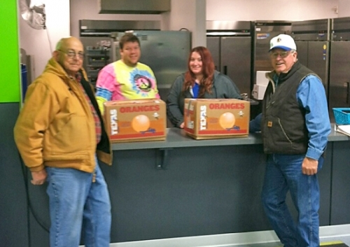 Members of the Huntington Lions Club deliver boxes of fruit to The Parkview Boys & Girls Club of Huntington County recently. Celebrating the occasion are (from left) Lion Steve Fulton, Tim Christy and Ivey Fordyce of the Boys & Girls Club and Lion Gary Yeiter.