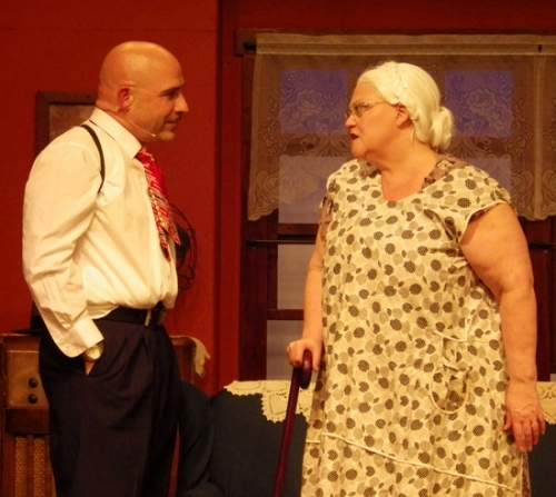 "Jonathan Kiernan (left) and Vickie Kibellus act out a scene in ""Lost in Yonkers,"" which runs through March 18 at the Pulse Opera House, in Warren."