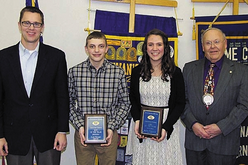 Crestview Middle School Outstanding Eighth Graders Reid Dillion (second from left) and Katie Paolillo (third from left) are honored by Crestview Middle School Principal Chuck Werth (left) and Huntington Metro Kiwanis member Jim Dinius (right).