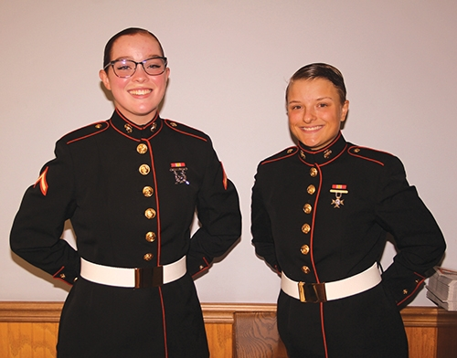 PFC Emily Paulette (left) and PVT Alyssa Aldred, both of Huntington, graduated from United States Marine Corps recruit training on March 8. Paulette and Aldred's training occurred in Parris Island, SC.