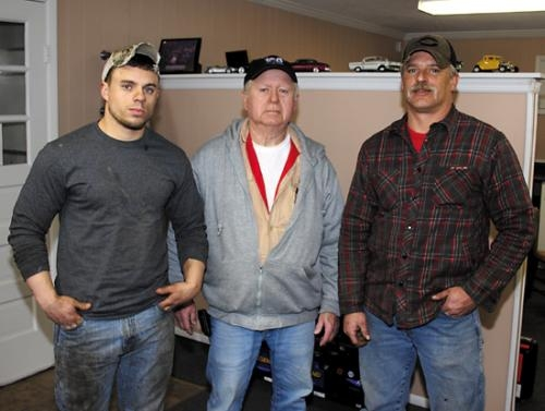 Dick Middaugh (center) owner of Middaugh's Collision & Auto Repair in Huntington, operates the business with son Rick (right) and grandson Nick. The shop is located at 755 S. Briant St.