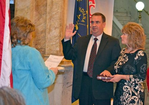 Jaime Miller (center) is sworn in for his first term on the Huntington County Council by Huntington County Clerk Kittie Keiffer (right) during a ceremony on Dec. 31 in the rotunda of the Huntington County Courthouse.