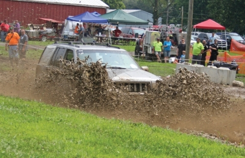 Robert Varney Jr. sends mud flying as he hits the gas in his Jeep during the Andrews Mud Bog last year at the mud pits at the end of Terrell Street. The annual event this year is a fund-raiser for Andrews volunteer firefighter Junior Jones.