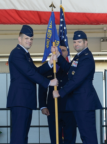 Col. Scott J. Nahrgang (right) accepts command of the 548th Intelligence, Surveillance and Reconnaisance Group from Col. Jason M. Brown during a ceremony on June 26 at Beale Air Force Base, in California. Nahrgang is the son of Huntington native Kay Paul Nahrgang.