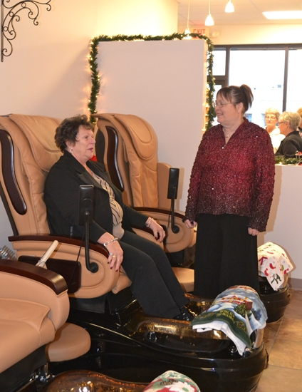 Greta Lesh (right), owner of The Nail Station, chats with client Diana Meier as Meier tries out one of the massaging chairs at the shop's new location, 317 Hauenstein Road.