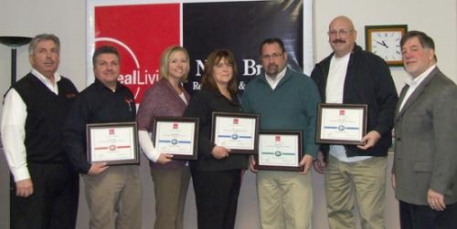 Agents with Real Living/Ness Bros. Real Estate & Auction Co. were recently honored with Medallion Awards. They are (from left) Steve Ness, Terry Miller,Dawn Harvey, Linda Sparks, Andy Eckert, Steve Smithley and Kurt Ness.