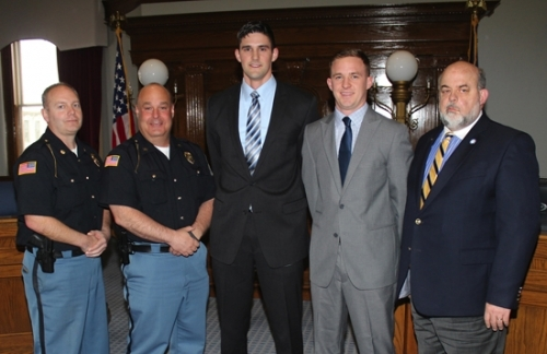 Brock Woodward and Rob Sands (third and fourth from left, respectively) were sworn in as officers with the Huntington Police Department on Thursday, March 31, in the Huntington City Council Chambers. With the two are (from left) Matt Hughes, assistant police chief; Chad Hacker, police chief; and Huntington Mayor Brooks Fetters.