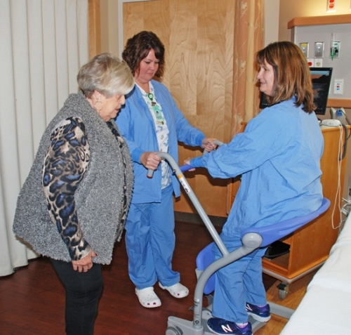 Parkview Huntington Hospital Family Birthing Center nurses Beth Crist (left) and Angie Skinner (right) introduce Anne Malone, president, Parkview Huntington Hospital Guild, to the new Sara Stedy lift. The assistive device is one of two purchased to help hospital patients with weakened muscles or mobility challenges, thanks to Guild funding through the Parkview Huntington Foundation.
