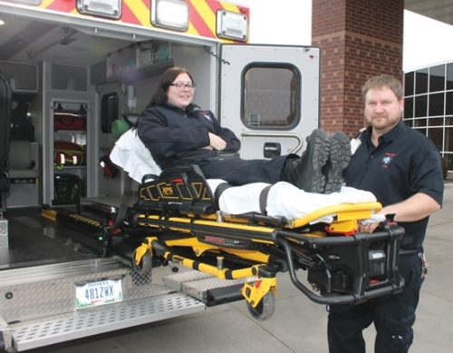 Jeremiah Tucker (right), a paramedic at Parkview Huntington Hospital, demonstrates the power stretcher, featuring an inline track that uses a power lift to load the stretcher into the hospital's new ambulance, as Emergency Medical Technician Alivia Eiting takes on the role of patient. The ambulance was on display at the front entrance of PHH on Friday, Jan. 11.