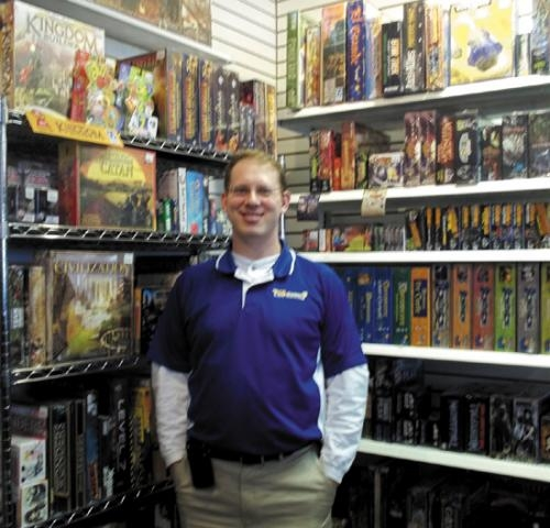Todd Nightenhelser, owner of The Collector's Box in Huntington, stands in his store at 515 N. Jefferson St., which recently became the 48th site of the Youth Services Bureau's Safe Place program.