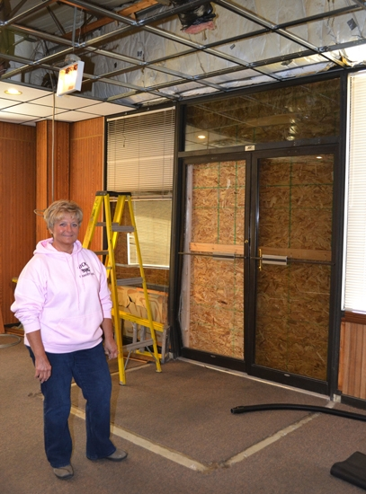 Nancy Bonebrake, co-owner of Nick's Country Café on Old U.S.-24, stands inside the restaurant's front door, boarded up after a car came crashing through on Jan. 23.