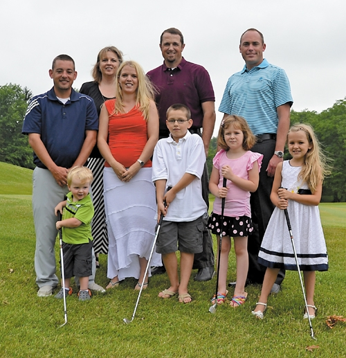 New owners of Norwood Golf Club and their families are (front, from left) T.J. Killen, Ethan Cutting, Kendra Killen and Adalyn Cutting; (middle row, from left) Lee and Stephanie Cutting; and (back, from left) Amanda and Kevin Killen and Jason Kennedy.