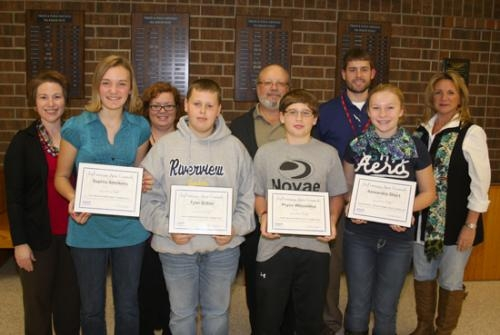 Riverview students (front row from left) Sophia Smekens, Tyler Ditton, Pryce Whisenhunt and Alexandra Short received artist of the month awards from the LaFontaine Arts Council.