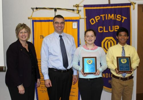 Mike Rohler (left), Optimist Club president, and Crestview Middle School Principal Chuck Werth (right), present Youth Appreciation Awards to Brenden Rice (second from left) and Audrey Marjamaa.