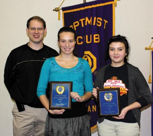 Huntington Catholic School students Audrey Wilcoxson (center) and Olivia Henderson (right) are the recipients of Huntington Optimist Club Youth Appreciation Awards. With them is Todd Nightenhelser, president of the Optimist Club.
